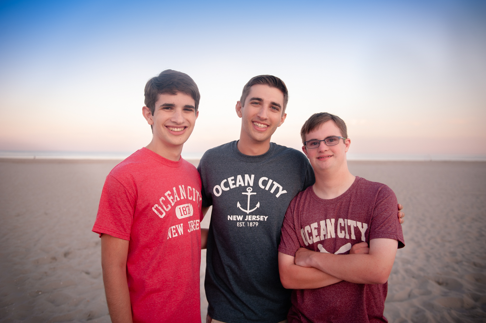 Three brothers on the beach