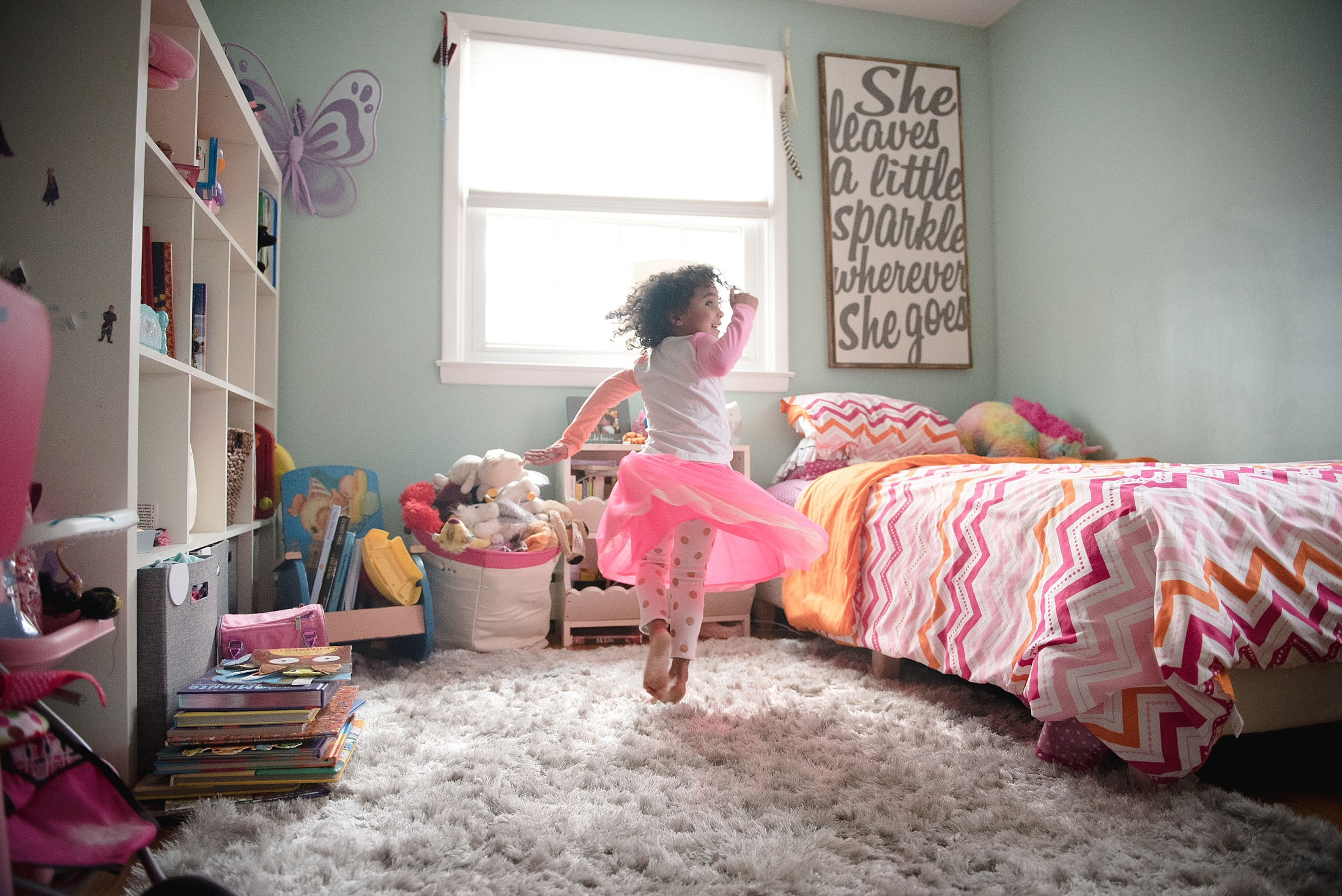 Little girl playing in her room